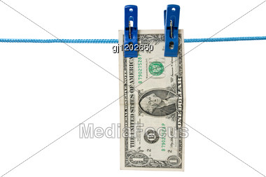 One Dollar Hung On A Washing Line, Symbolising Money Laundering Stock Photo
