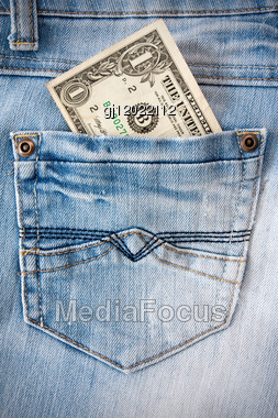 One Dollar In The Blue Jeans Pocket Stock Photo
