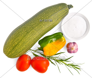 One Green Zucchini, Two Red Tomatoes, One Yellow Bell Pepper, Garlic, Tarragon, A Dish Of Salt Is Isolated Stock Photo