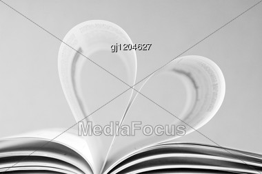 Open Book With Bent Pages In The Shape Of Heart Stock Photo