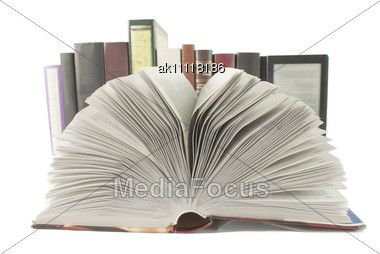 Open Book With A Row Of Books And Ebook Behind It Stock Photo