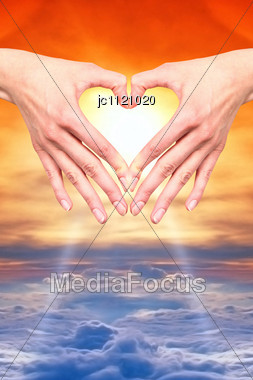 Open Hand In The Heart Of A Sunset Or Sunrise To Air On A Bed Of Clouds Stock Photo