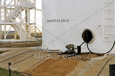 Open The Hatch In The Oil Tank, Number Of Dirty Boots, Soaked With Oil. Stock Photo