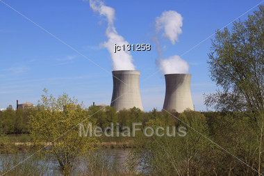 Operating Nuclear Power Plant On The Banks Of A River Surrounded By Trees Stock Photo