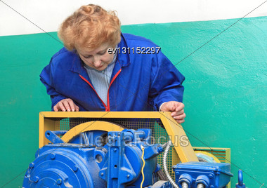 Operator Woman-engineer In Machine Room (elevator) Check The Mechanical Equipment Stock Photo