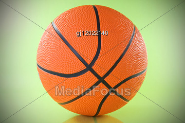 Orange Basketball Ball Over A Green Background Stock Photo