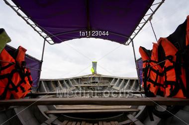 Orange Life Jackets On The Boat Stock Photo