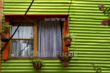 Orange Wood Window And A Green Metal Wall In La Boca Buenos Aires Argentina Stock Photo