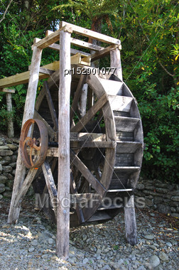 Original Water Wheel In Bush Near Ross Township, West Coast, South Island, New Zealand Stock Photo