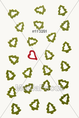 Ornamental Heart Between Fir-trees On White Background Representing Christmas. Stock Photo