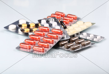 Packs Of Pills And Tablets. Medical Background Stock Photo