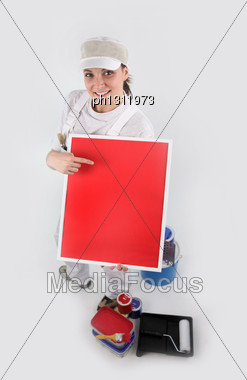 Painter Holding A Blank Red Sign Stock Photo