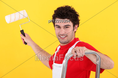 Painter Holding A Paint Roller Stock Photo