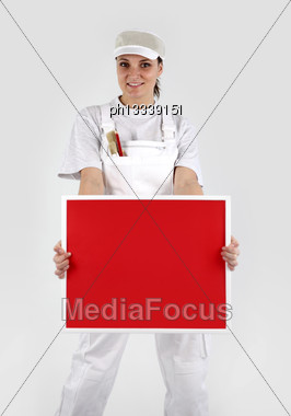 Painter Holding Up A Red Sign Stock Photo