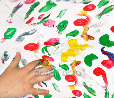 Painting With Her Fingers With Different Color Paint Stock Photo