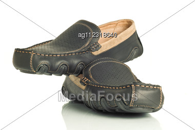 Pair Of Modern Black Mens Shoes Moccasins Over White Stock Photo
