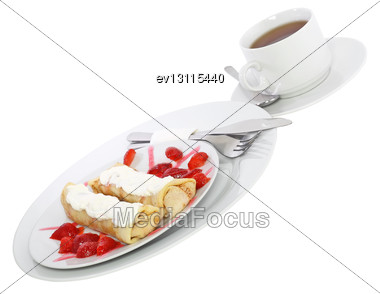 Pankcake With Cream , With Rolled Fruit Inside And Strawberry Around. Isolated Stock Photo