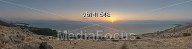 Panorama Of Lake Kinneret At Sunset From The Slopes Of The Golan Heights (Israel Stock Photo