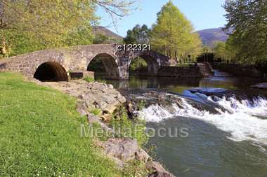 Panoramic Photo Of A Waterfalls River Under A Bridge Stock Photo