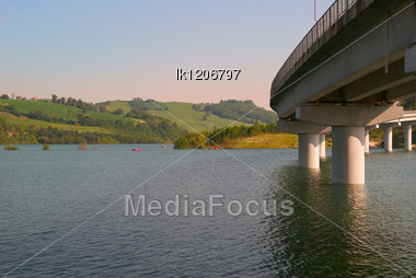 Panoramic Sunset Landscape Lake In Italy And The Bridge Stock Photo