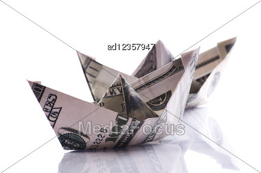 Paper Boats From Dollars Banknote On White Stock Photo