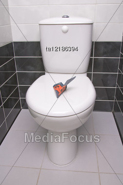 Paper Plane Is On The Water-closet Lid Stock Photo