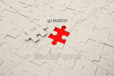 Papper Puzzle Background With One Red Piece Missing Stock Photo