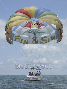 Parasailing Tourboat Stock Photo