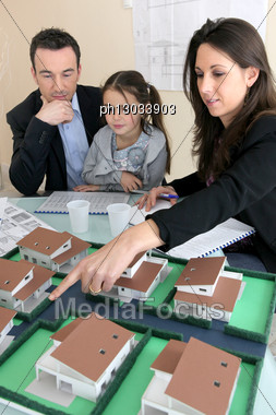 Parents Showing Daughter New House Plans Stock Photo