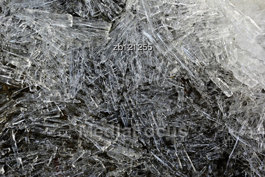 Part Of Ice Block Against Clear Blue Sky With Backlight, Melting. Stock Photo