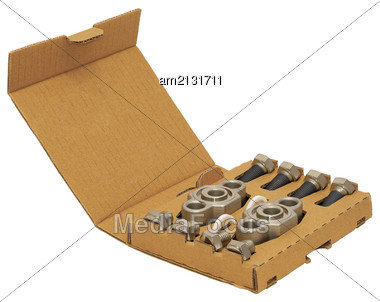 Parts For Wear In A Cardboard Box, Isolated On A White Background Stock Photo