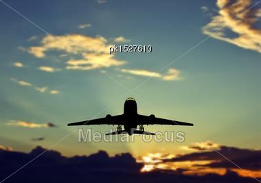 Passenger Jet Airplane Silhouette In Blurred Sunset Sky. Vector Illustration Stock Photo