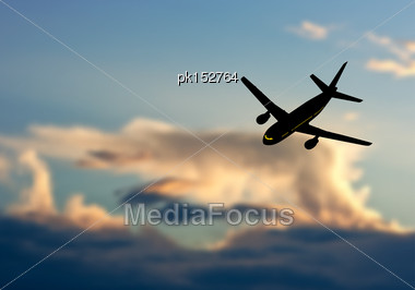 Passenger Jet Airplane Silhouette In Blurred Sunset Sky. Vector Illustration Stock Photo