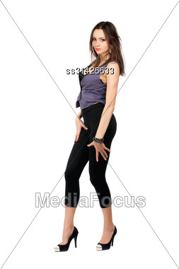 Passionate Young Brunette Wearing Tight Black Leggings And Grey Vest. Isolated On White Stock Photo
