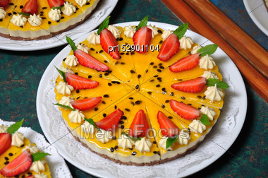 Passionfruit Cheesecake With Strawberries And Mint Stock Photo