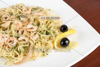 Pasta With Shrimps Lemon And Olive - Tasty Dish Stock Photo