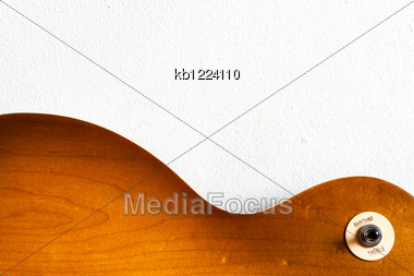 Pattern Wood Of Electric Guitar Honey Burst Color With Texture Of White Wall Stock Photo