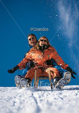 winter vacation sledding Stock Photo