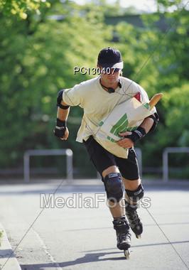 skate holding buy Stock Photo