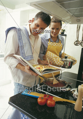cook couple kitchen Stock Photo