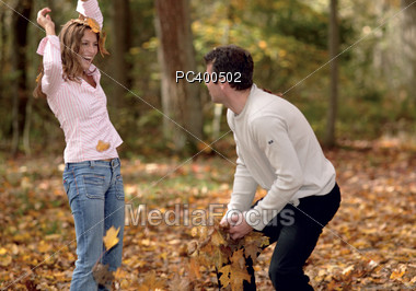 fun leaves young Stock Photo
