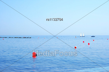 Peaceful Sea View With Red Buoys Stock Photo