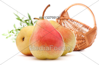 Pear Fruit And Wicker Basket Isolated On White Background Cutout. Autumn Harvest Concept Stock Photo