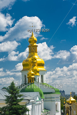 Pecherskaya Laura In Kiev. Cupola Of Orthodox Church And Blue Sky With Clouds Stock Photo