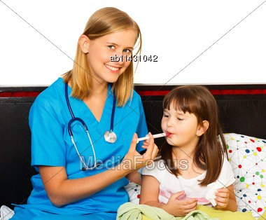 Pediatrician Administrating Daily Syrup Dose For Little Patient Stock Photo
