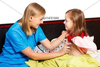 Pediatrician Examining With Stethoscope Her Little Patient Stock Photo