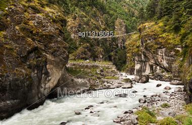 Pendant Bridge On The Way From Lukla To Namche Bazar In Himalaya, Nepal Stock Photo