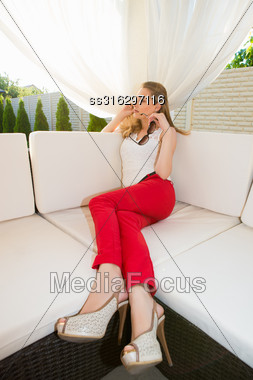 Pensive Blond Woman Wearing Red Panties Relaxing In Summer House Stock Photo