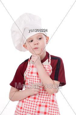 Pensive Child Chef Stock Photo