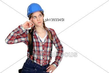 Pensive Female Builder Stock Photo
